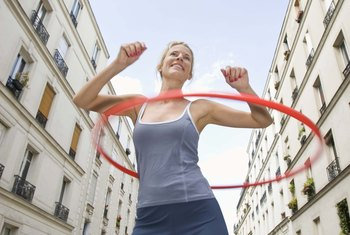 Hula hoops help you burn calories and fat, but you can't directly target your midsection for slimming down.