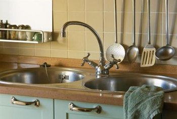 Sink fixtures, such as faucets, wobble if the nuts holding them aren't tight.