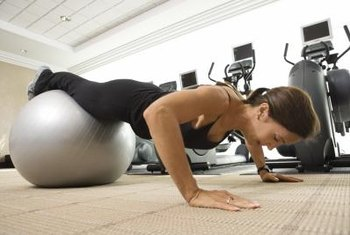 Don't neglect traditional body-weight exercises such as pushups as part of your lean muscle-building routine.