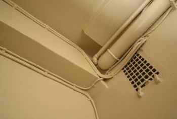 Hide pipes in a way that does not interfere with vents or wiring.