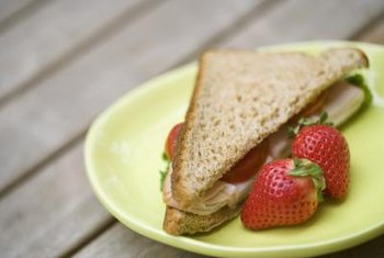 A sandwich on whole-grain bread is a healthy snack for a swimmer.