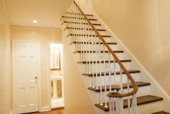 A narrow hallway can look wider if you use light colors and the right lighting.