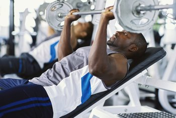 A chest press on an incline bench emphasizes the upper chest.
