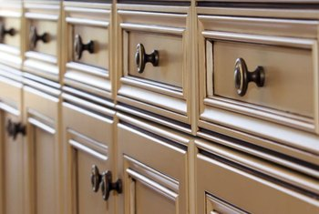 Match the decorative details and hardware on old and new cabinets to tie the look together.