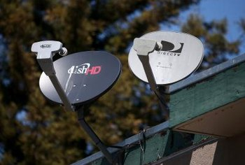 A satellite TV installer has to install a satellite dish in the right position to ensure that it will work properly.