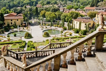 A large well maintained garden outside a villa in Tuscony, Italy.