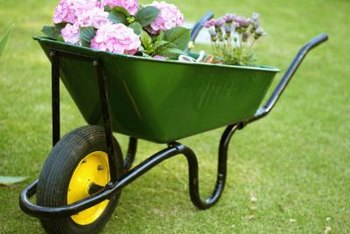 A deep-basined garden wheelbarrow has a 3-cubic-foot capacity.