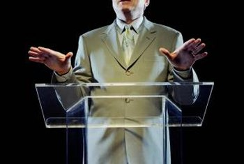 Using a podium for speaking sets a formal tone for the presentation.