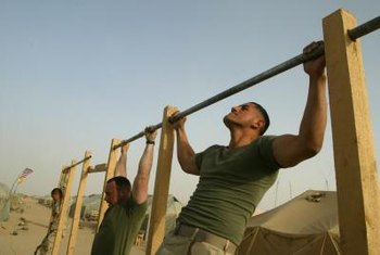 Kipping pull-ups use more muscles than traditional pull-ups.