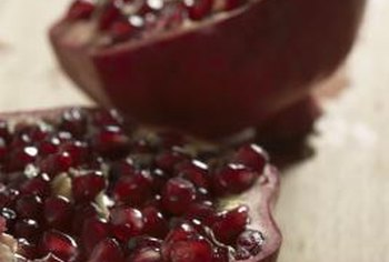 To eat pomegranates, red seed casings must be separated from the inedible white pulp.