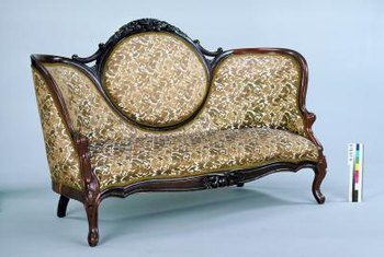 Rococo Revival furniture often features curves and dark woods.