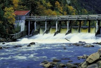 Chemiosmosis generates power like water that generates electricity by flowing through a dam.