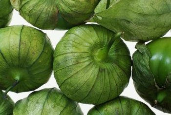The tomatillo grows in a papery husk that should remain on the fruit until it is ready to be consumed.