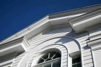 Vinyl siding panels overlap each other and lock into place.