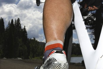 Pedaling a bike causes eccentric and concentric contractions in your calf muscles.