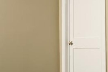 Trim the hinge side of a hollow core door to make the door fit its opening.