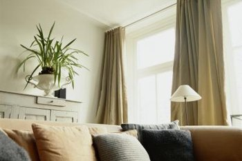 Curtains that fall from the ceiling create a sense of height in a room.