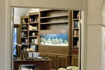 Save space by incorporating your aquarium into furniture.