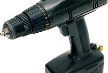 A cordless drill can be used to attach brackets to tile floors and door jambs.