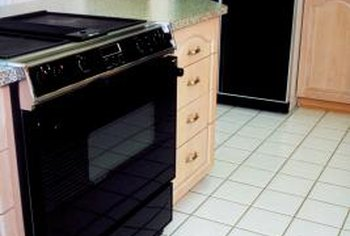 Slide-in stoves accentuate island cabinets.
