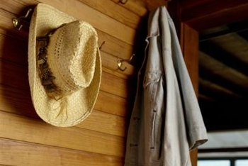 Wall hooks are used to hang coats and hats by an entryway.