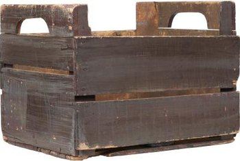 Use an old box to hold garden tools or cleaning supplies.