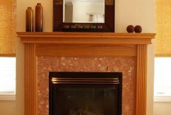 Balance is one key to bringing a high mantel wall down to a manageable size.