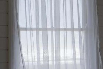 A knotted sheer curtain valance adds elegance to a window.