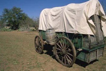 The covered wagon evokes the westward journey.