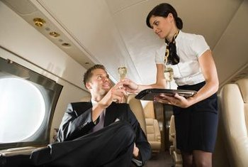 Take hospitality courses at a community college to prepare for flight attendant school.