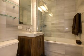 Glass splash guards help keep your shower enclosure from feeling small.