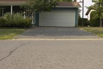 Resurfacing a drab concrete driveway with stamped concrete or pavers instantly gives it a more decorative look.