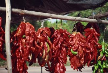 Dry chili peppers by hanging them in the sun or a warm room.