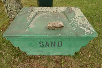 Sand can help to even out a lawn for better drainage.