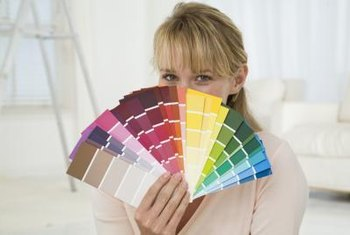 Paint swatches can be repurposed into a colorful cornice board treatment.