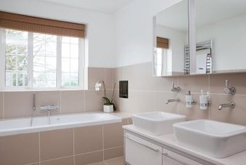 A window over a bathtub allows natural light into a potentially shadowy space.
