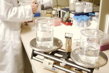 Environmental scientists test water samples for public health hazards.
