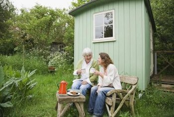 Small garden sheds will fall in high winds without support.