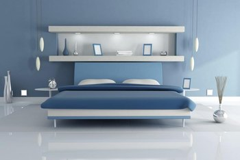 Pure white shelves bring out the cool tones of light blue walls.