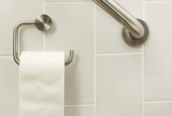 Grab bars provide added safety to a handicapped-accessible bathroom.