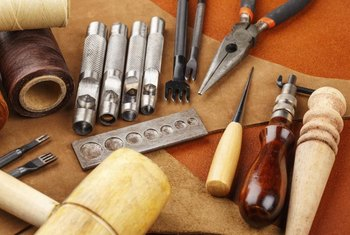 The wooden tool on the far right is for burnishing leather.