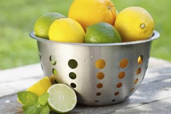 Sliced lemons and limes create festive decor as part of a summertime centerpiece.