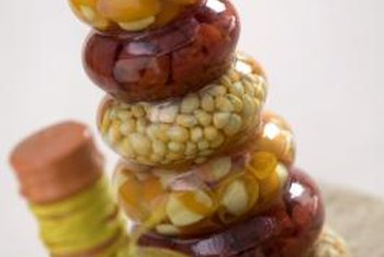 Fill odd-shaped bottles with colored stones or even pantry items.
