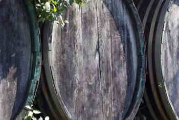 Whiskey barrels can support one large herb plant or several small plants.