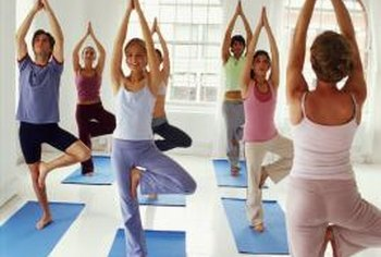 Fitness trainers may specialize in one or more disciplines such as yoga or Pilates.
