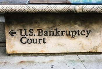 Court-appointed trustees monitor a company during bankruptcy proceedings.