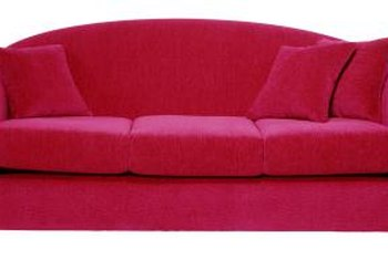 A scarlet red couch is a bold, colorful focal point.