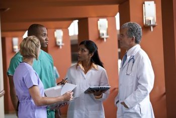 Medical professionals use communication skills to collaborate on patient care.