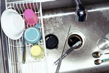 Remove and replace a scratched or rusted sink flange.