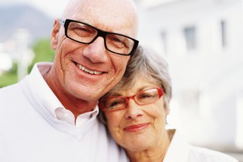 Elderly couple wearing glasses.